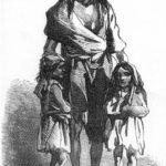 飢饉のただ中にいる母親と2人の子供